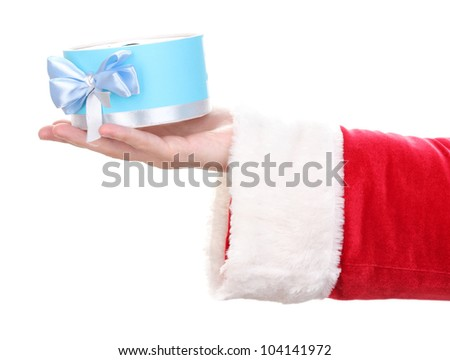 Santa Claus hand holding gift box isolated on white