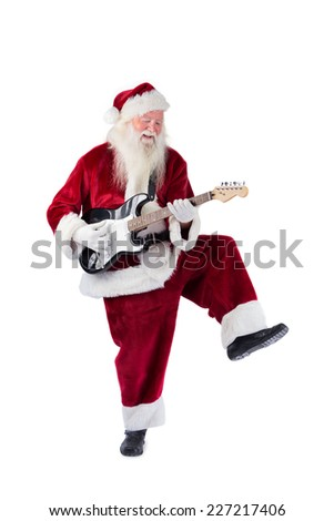 Santa Claus has fun with a guitar on white background - stock photo
