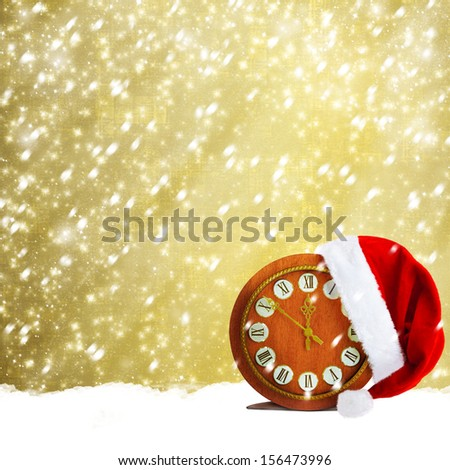 Santa Claus hat and watch. Christmas snowy night - stock photo