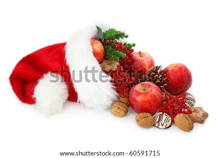 Santa claus hat filled with christmas food - stock photo