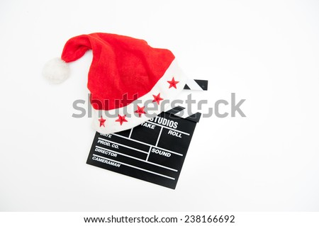 Santa Claus hat on a movie clapper board isolated on white background - stock photo