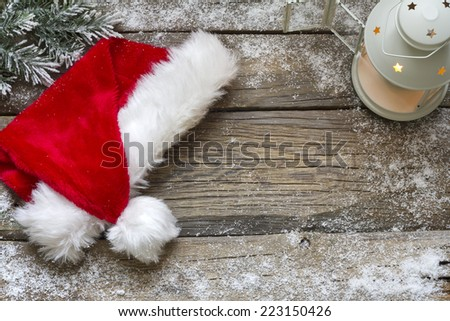 Santa Claus hat on vintage wooden boards christmas background - stock photo