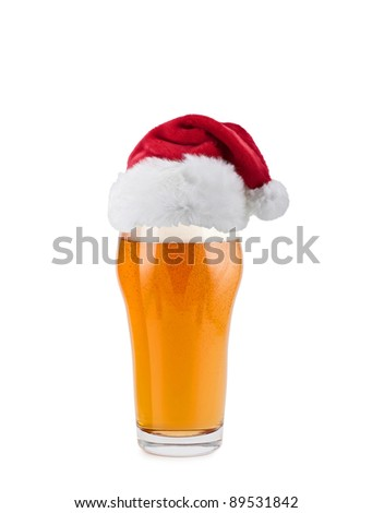 Santa Claus hat with beer - stock photo