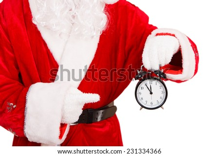 Santa Claus Holding a Alarm Clock - stock photo