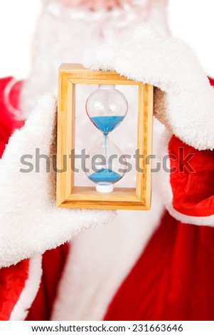 Santa Claus Holding a Hourglass - stock photo