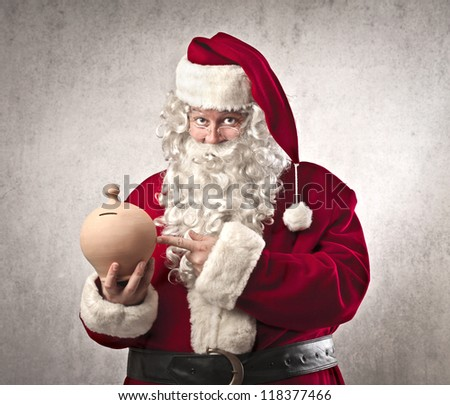 Santa Claus holding a vessel for the money - stock photo
