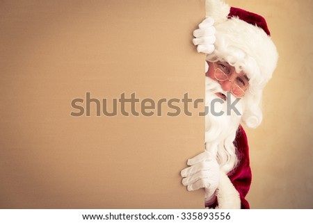 Santa Claus holding banner blank. Christmas holiday concept - stock photo