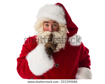 Santa Claus holding, finger on mouth - silence gesture - Closeup Portrait. Isolated on White Background - stock photo