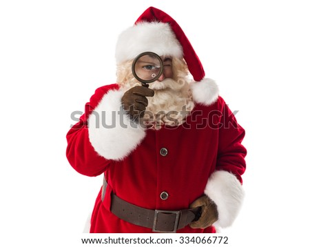 Santa Claus holding magnifier Closeup Portrait. Isolated on White Background - stock photo