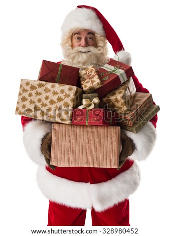 Santa Claus holding pile of gift boxes Closeup Portrait - stock photo