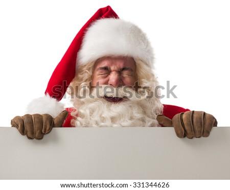 Santa Claus holding white blank sign Closeup Portrait. Isolated on White Background - stock photo