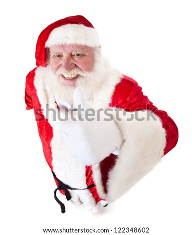 Santa Claus in authentic costume showing thumbs up. All on white background. - stock photo