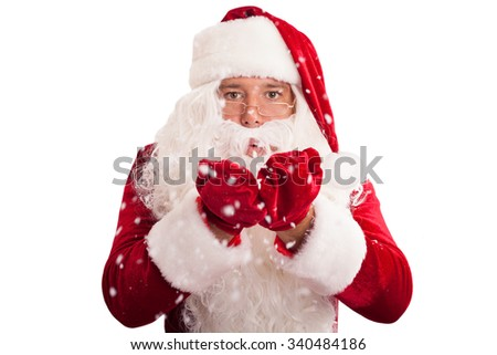 Santa Claus in eyeglasses blowing snow isolated on white