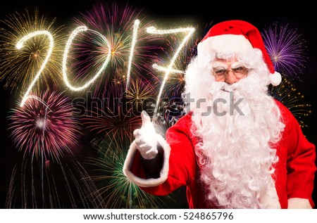 Santa Claus in front of New Year fireworks