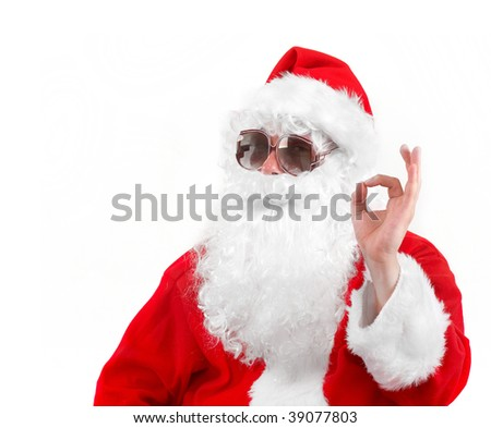santa claus in shades showing an ok sign - stock photo