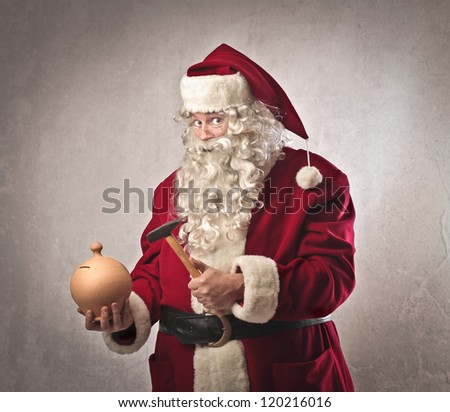 Santa Claus is going to break a vessel full of money - stock photo