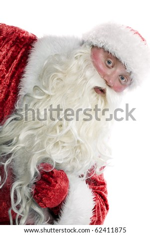 Santa Claus is looking from the corner - stock photo