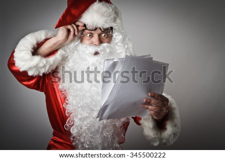 Santa Claus is reading the letters - stock photo