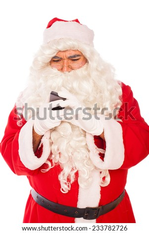 santa claus looking at his mobile phone, isolated on white  - stock photo