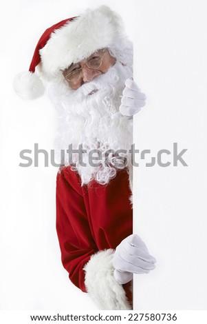 Santa Claus Looking Round Blank White Wall - stock photo