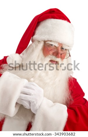 Santa - Claus looks Intently Through his Glasses Directly at the Camera on a White Background