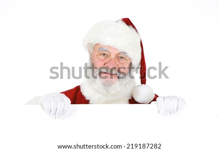 Santa Claus Looks Over A White Card