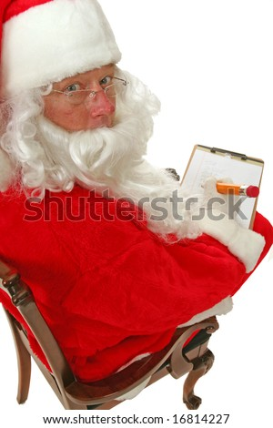 Santa Claus looks over his shoulder while checking his list of whos good and bad  isolated on white - stock photo