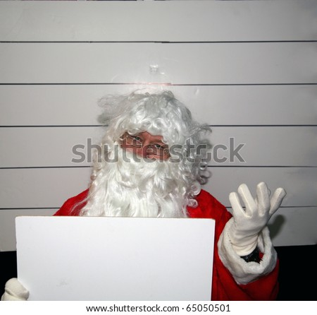 Santa Claus Mugshot. Santa holds a blank white booking sign while his mugshot is taken. Booking Sign is blank for your text.