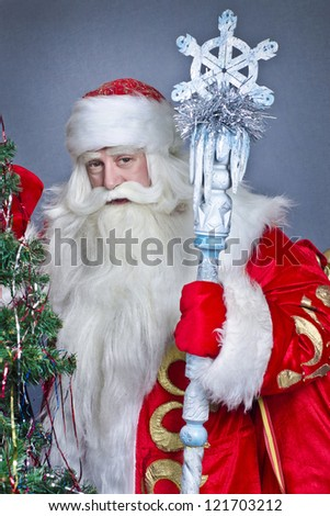 Santa Claus on a blue background with a tree