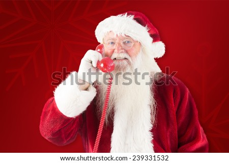 Santa claus on the phone against red background