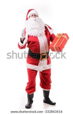 Santa Claus on white background with gifts - stock photo