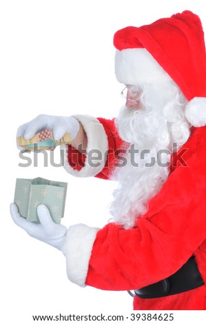 Santa Claus Opening a Gift Box, isolated on white, vertical composition, profile