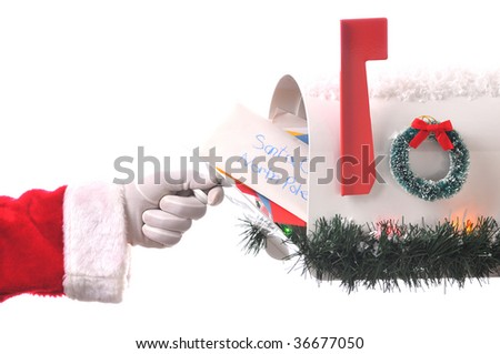 Santa Claus Opening His Mailbox stuffed with letters. Horizontal composition isolated on white, Hand and arm only. - stock photo