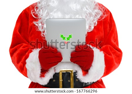 Santa Claus or Father Christmas looking at his mobile tablet computer, isolated on a white background. - stock photo