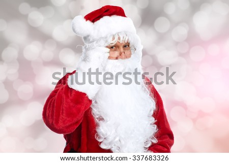 Santa Claus over sparkle Christmas abstract background. - stock photo