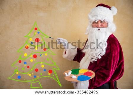 Santa Claus painter. Christmas holiday concept - stock photo