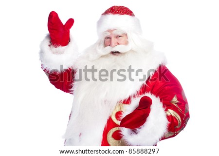Santa Claus pointing his hand isolated over white. - stock photo