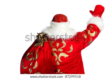Santa Claus pointing his hand isolated over white. Photo from behind