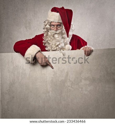 Santa Claus pointing out something  - stock photo