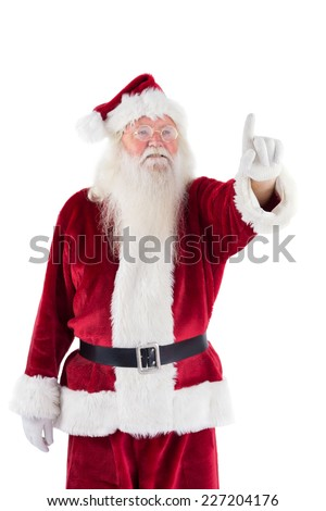 Santa Claus points at something on white background