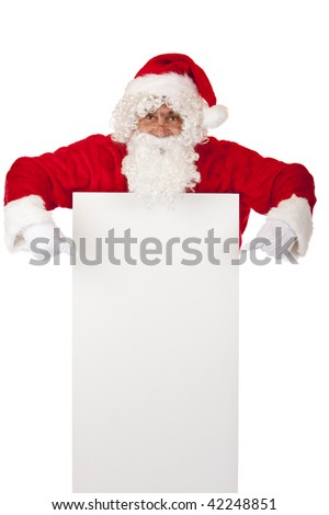 Santa Claus points on Christmas advertisement offer. Isolated on white.