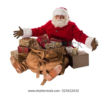 Santa Claus Portrait sitting with sack and gifts Isolated on White Background - stock photo