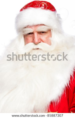 Santa Claus portrait smiling isolated over a white background and soap bubbles on foreground