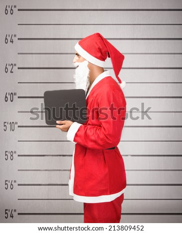 Santa Claus prisoner lateral view - stock photo