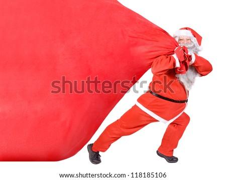 santa claus pulling a big bag - stock photo