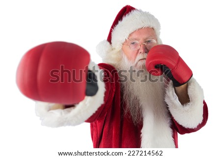 Santa Claus punches with his right on white background - stock photo