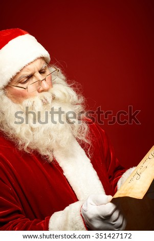 Santa Claus reading Christmas letter on poster