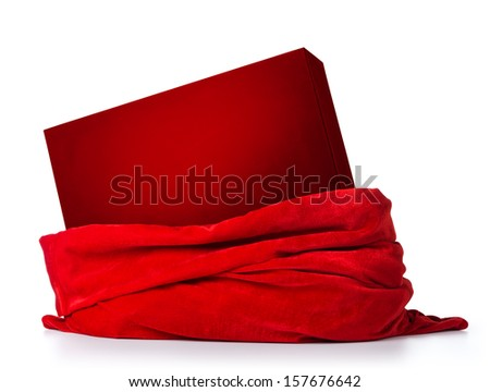 Santa Claus red bag with red box with a gift on white background. File contains a path to isolation  - stock photo