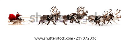 Santa Claus rides in a reindeer sleigh. He hastens to give gifts before Christmas.  - stock photo