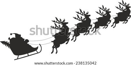 Santa Claus riding in a sledge - stock photo
